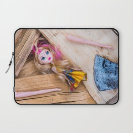Barbie style doll and axe on chopped wood Laptop Sleeve