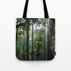 Green forest shrouded the sun. Tote Bag