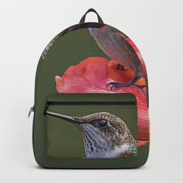 Humming bird resting on a flower Backpack