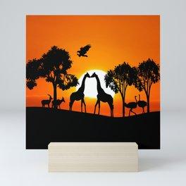Giraffe silhouettes at sunset Mini Art Print