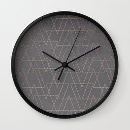 Modern rose gold geometric triangles blush pink abstract pattern on grey cement industrial Wall Clock