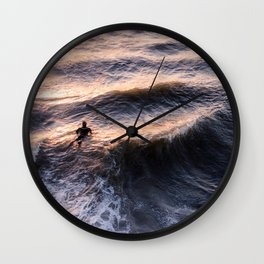 Lone surfer at sunset waiting for the next wave Wall Clock