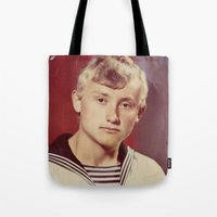 soviet Tote Bags featuring The Soviet seaman. by Mikhail Zhirnov