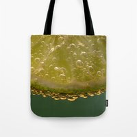 lime green Tote Bags featuring Lime! by Caroline Benzies Photography