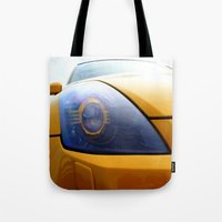 transformer Tote Bags featuring The Eye Of A Transformer by VHS Photography