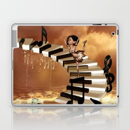 Cute little girl dancing on a piano Laptop & iPad Skin