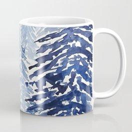 A snowy pine forest Coffee Mug