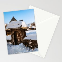 Traditional handcrafted gate and a rural Romanian homestead covered in snow Stationery Cards