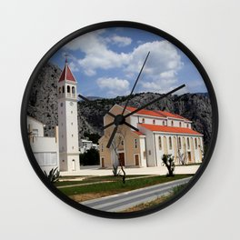Church in Croatia under blue sky between mountains and sea Wall Clock