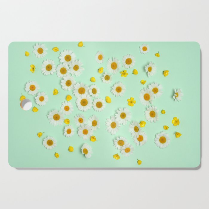 Composition of daisies and buttercups Cutting Board