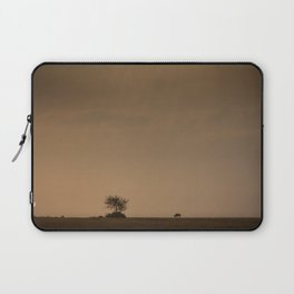 Lone wildebeest grazing in South Africa at sunset Laptop Sleeve