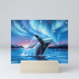 Humpback whale breaching water with breathtaking aurora shimmering on dreamy starry Mini Art Print