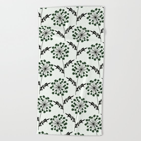 Delicate flowers on a black background. Beach Towel