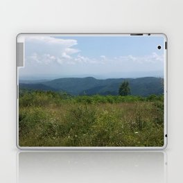 Meadow and mountains in the distance Laptop & iPad Skin