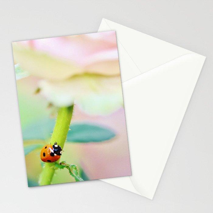 Ladybird on pink rose stem Stationery Cards