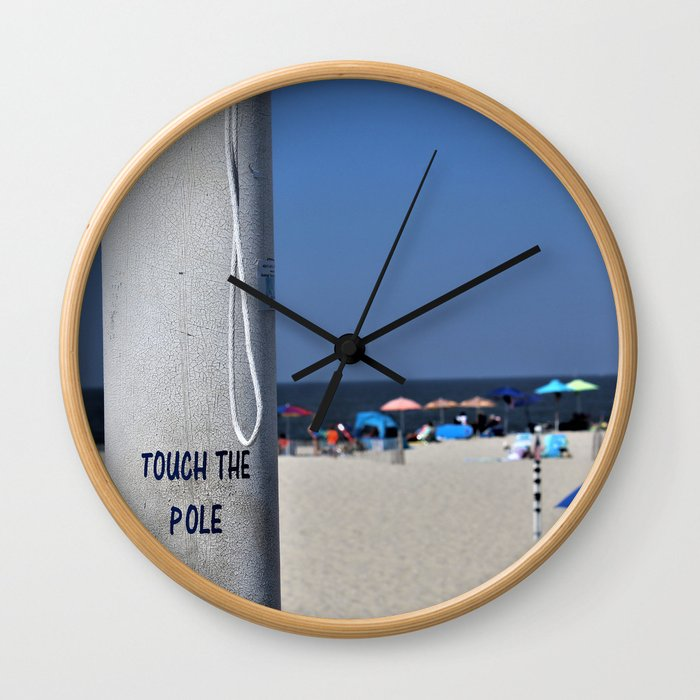 Touch  the Pole Wall Clock