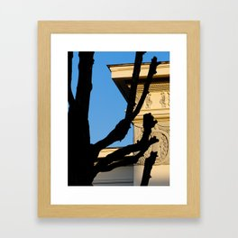 Black tree silhouette, part of building exterior and clear blue sky at background Framed Art Print