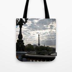 Eiffel Tower past a bridge Tote Bag