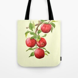 red apple in yellow background Tote Bag