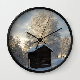 Snowy cabins and light in the trees Wall Clock