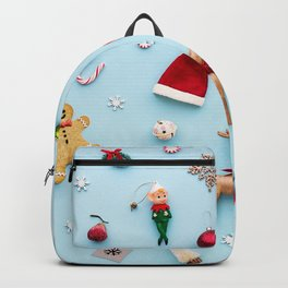 Collection of Christmas objects viewed from above Backpack