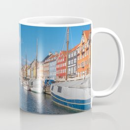 Nyhavn Canal under a blue sky with some clouds Coffee Mug