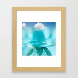 Little girl in water, with clouds Framed Art Print