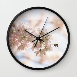 Bee and cherry branches against the blue sky Wall Clock