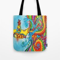 yellow submarine Tote Bags featuring The Yellow Submarine by Nick Swann