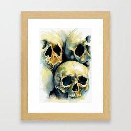 Orangelight skulls Framed Art Print