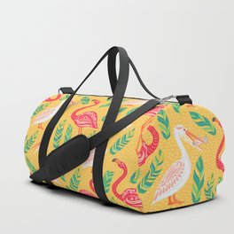 Pink flamingos, pelicans, tropical leaves on yellow background. Decorative seamless vector pattern. Duffle Bag