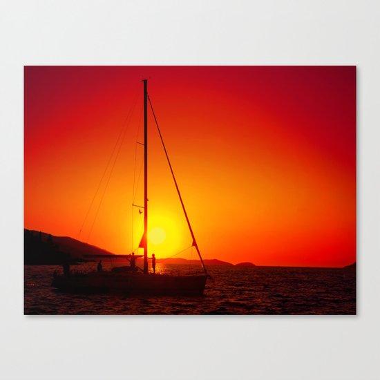 A sailboat at sunset Canvas Print