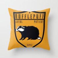 hufflepuff Throw Pillows featuring Hufflepuff Crest by machmigo
