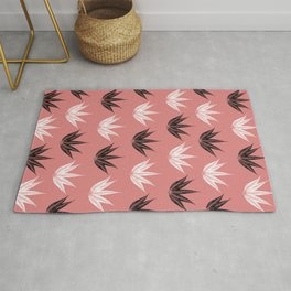 White and black fine leaves in pink background Rug