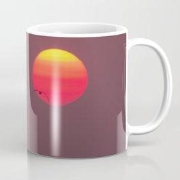 Bird flying into the Sunset Coffee Mug