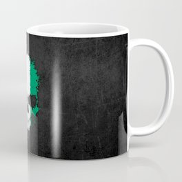 Flag of Ivory Coast on a Chaotic Splatter Skull Coffee Mug