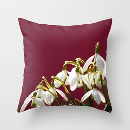 Snowdrops on a red background Throw Pillow