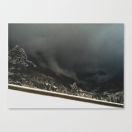ominous snow storm in the valley Canvas Print