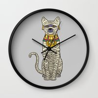 returns Wall Clocks featuring Ancient Cat Returns by Fathi