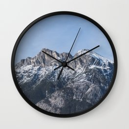 The snow on the mountains melts away on a sunny spring day in Austria. Wall Clock