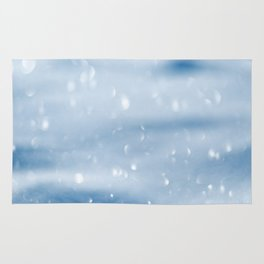 Blue sparkly defocused snowflakes Rug