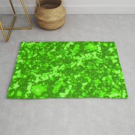 A chaotic cluster of green bodies on a light background. Rug
