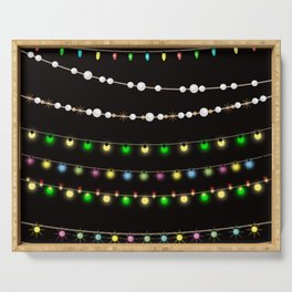 Colorful festive Christmas garland and beads . Serving Tray