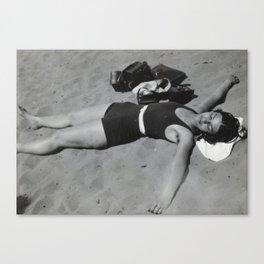 Vintage photo of sunbather on the beach Canvas Print