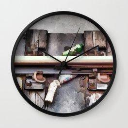 Bottles on the subway tracks Wall Clock
