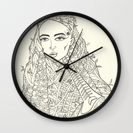 Woman with skulls earrings Wall Clock