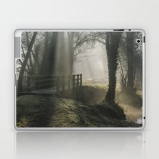 Sunlight through mist and fog over an old wooden footbridge. Norfolk, UK. Laptop & iPad Skin