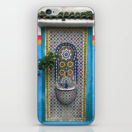 Turquoise wall and water fountain in Morocco iPhone Skin