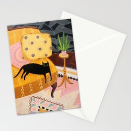 black cat on mustard yellow sofa painting by Tascha Stationery Cards