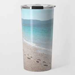 White sandy beach with blue sea, mountains in the back Travel Mug